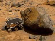 The Sojourner rover examining a rock